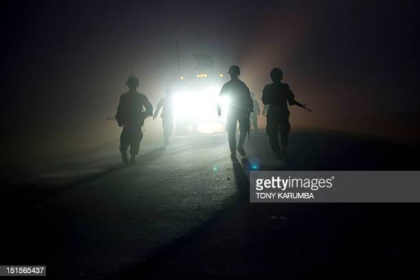 Soldiers on a joint patrol comprising officers from the 1st Platoon 164 Armored Batallion of the US Army operating under NATO command and Afghan...