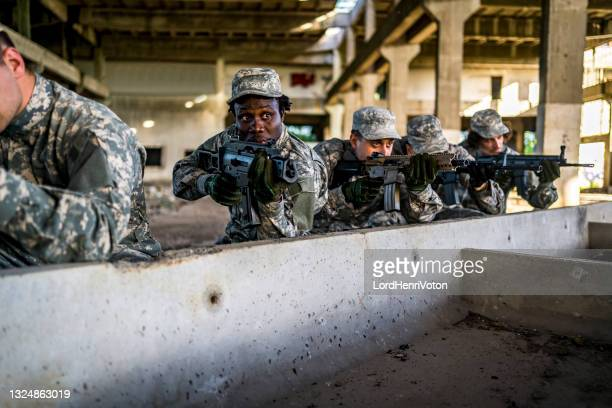 soldiers on a mission - military invasion stock pictures, royalty-free photos & images