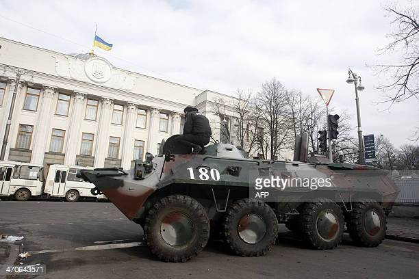 Soldiers on an APC guard the Ukrainian parliament in Kiev on February 20 2014 Ukraine's brittle truce shattered on Thursday in fierce clashes between...