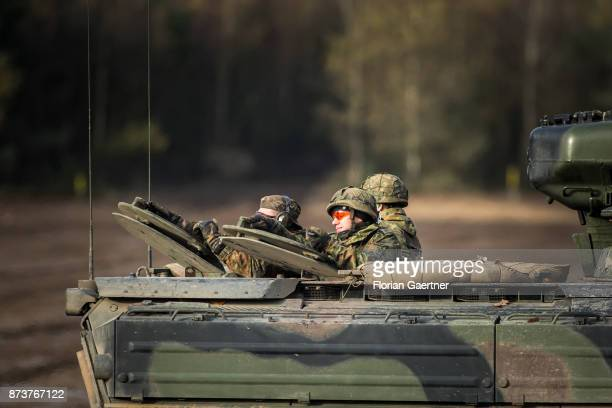 Soldiers on an armored infantry fighting vehicle. Shot during an exercise of the land forces on October 13, 2017 in Munster, Germany.