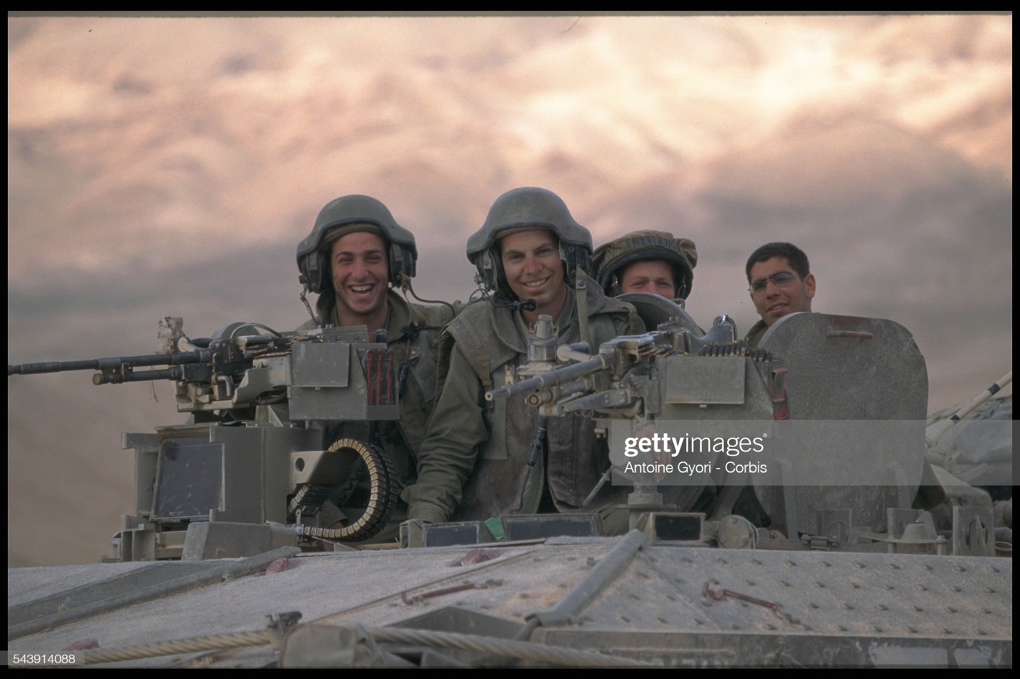 https://media.gettyimages.com/photos/soldiers-on-board-a-tank-picture-id543914088?s=2048x2048