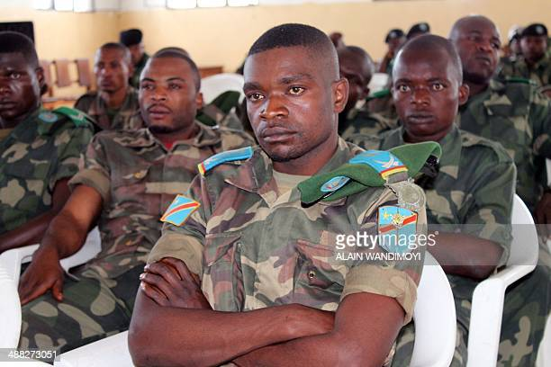 Soldiers on charges including rape and murder during a 2012 army offensive wait for their trial in a Goma military court on May 5, 2014. A lieutenant...