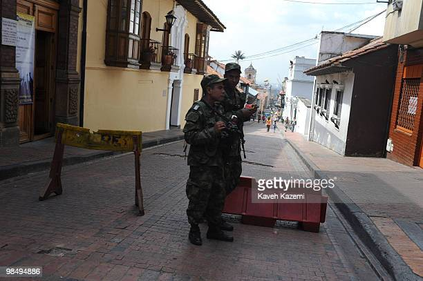 Soldiers on duty eat ice cream at a roadblock in Candeleria in the old part of the city Bogota formerly called Santa Fe de Bogota is the capital city...