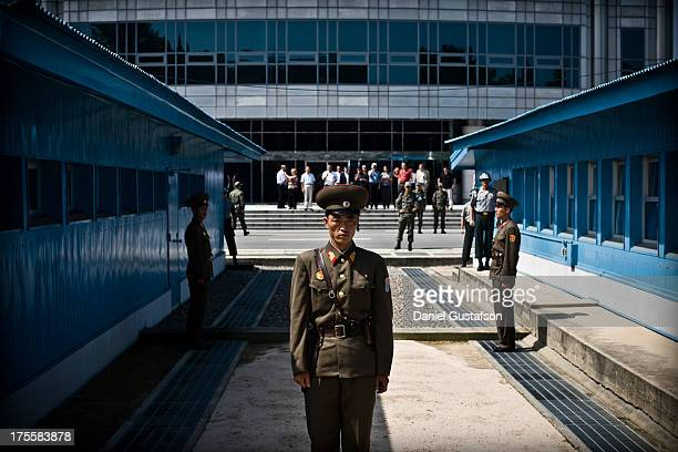 CONTENT] Soldiers on patrol at the most heavily militarized border in the world the demarcation line between North and South Korea taken from the...