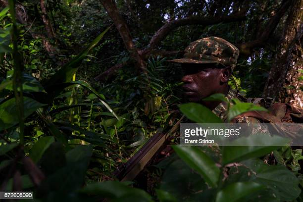 Soldiers on patrol from the African Union Ugandan Armed forces UPDF base at Mboki Central African Republic The Ugandan contingent based here are...