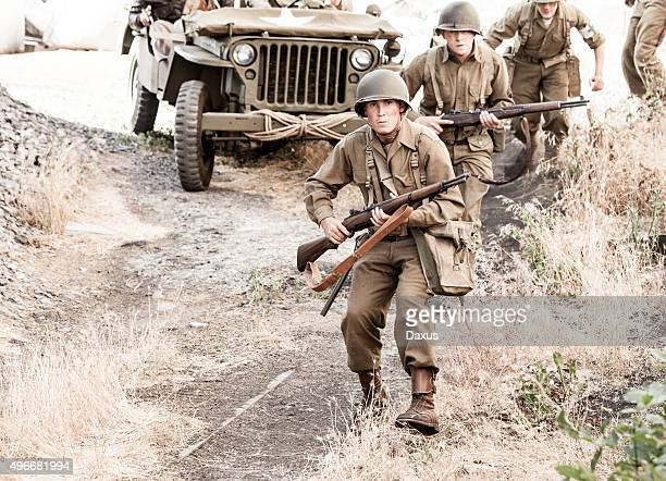 soldiers on patrol wwii - world war ii stock pictures, royalty-free photos & images