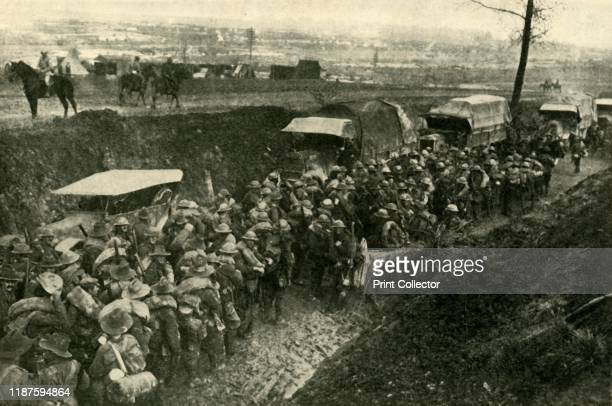"Soldiers on the Western Front in northern France, First World War . ""Advance, Australia!"" Commonwealth troops leaving their base camp for the..."