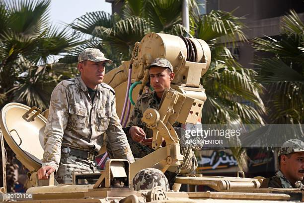 soldiers on top of an army vehicle in cairo - egyptian army stock pictures, royalty-free photos & images