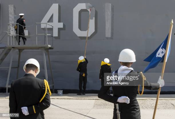 Soldiers paint the number of Turkish Navy frigate TCG ERTUGRUL which was built at Wisconsin State and got veteran title after it was used on Cyprus...