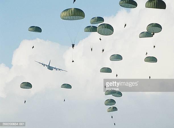 soldiers parachuting after training jump from lockheed c-130 hercules - fallschirm stock-fotos und bilder
