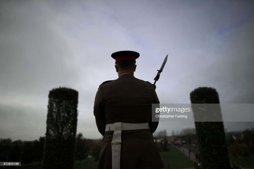 Soldiers parade and pay their respects as they attend the annual Armistice Day Service at The National Memorial Arboretum on November 11, 2017 in Alrewas, England. Armistice Day traditionally marks the end of the WWI when Germany and the allied forces signed the armistice signaling the end of hostilities on the Western Front. The cessation of the war officially took effect on the eleventh hour of the eleventh day of the eleventh month and is marked annually by services of remembrance for all those who have fallen in wars and a two minute silence.