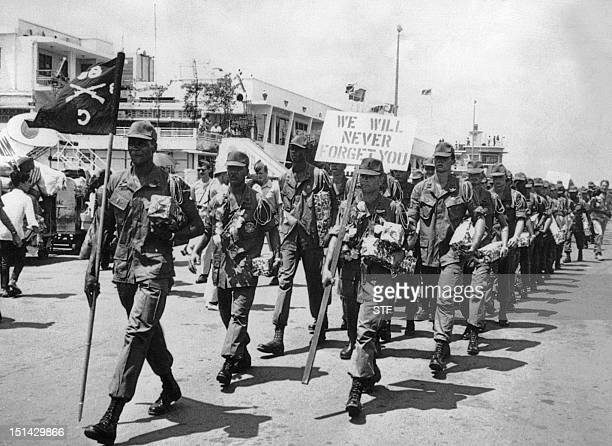 Soldiers parade during a ceremony just before leaving Vietnam 11 July 1969 during the Vietnam War at Tan Son Nhut airport in Saigon. They are the...