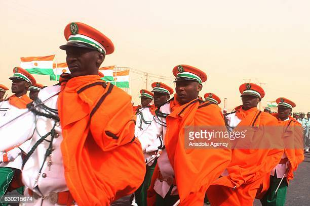 Soldiers parade during a ceremony marking the 58th anniversary of proclamation of the republic in Agadez Niger on December 18 2016