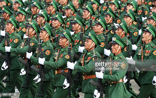 Soldiers parade in front of the mausoleum of late president Ho Chi Minh, founder of today's communist Vietnam, as the communist regime celebrates its...