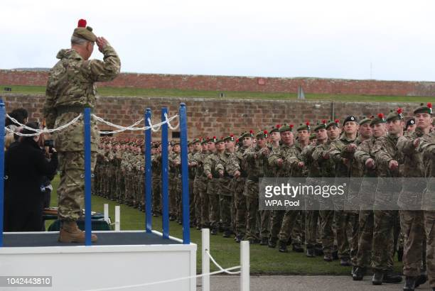 Soldiers parade past Prince Charles, Prince of Wales, known as the Duke of Rothesay whilst in Scotland, after he presented Iraq campaign medals to...