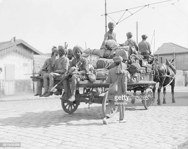Soldiers part of the 3rd Indian Division seen here escorting one of the transports from the docks to their rest camp on the race course at Marseilles...