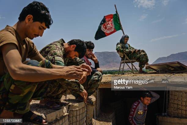 Soldiers pass time at an Afghan National Army base in Arghandab District, Afghanistan, Tuesday, May 4, 2021. Arghandab, a district lush with fruit...