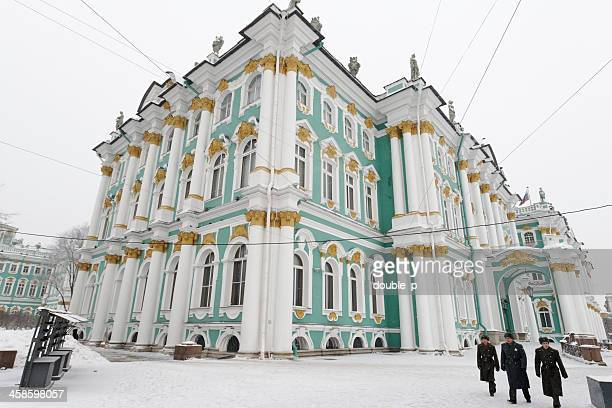 soldiers passing the hermitage - winter palace st. petersburg stock photos and pictures