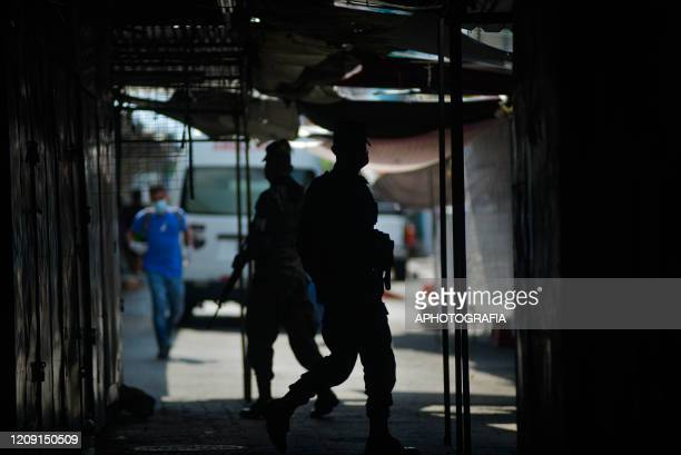 Soldiers patrol a closed market to ensure people comply with the government issued curfew on April 3 2020 in San Salvador El Salvador On March 21st...
