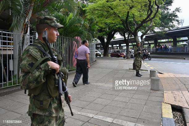 Soldiers patrol a street in Cali, Colombia on November 22 a day after a national strike called by students, unions and indigenous groups to protest...
