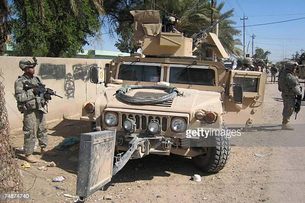 US soldiers patrol a street in the restive city of Baquba northeast of Baghdad 24 June 2007 According to witnesses six suspects were arrested today...