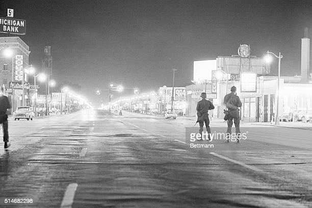 Soldiers patrol a street on Detroit's west side during a period of severe racial rioting