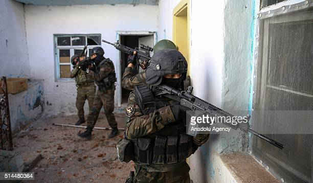 Soldiers patrol at a street as Turkish Security Forces carry out a counter terrorism operation against terrorist organization PKK in Turkey's...