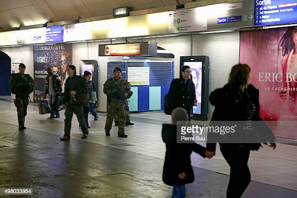 Soldiers patrol at 'Auber' RER station on November 20 2015 in Paris France A CCTV camera at the Croix De Chavaux train station captured Abdelhamid...