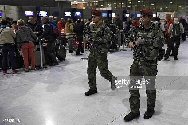 Soldiers patrol at Paris' Charles de Gaulle airport as part of security measures set following a series of coordinated attacks in and around Paris on...