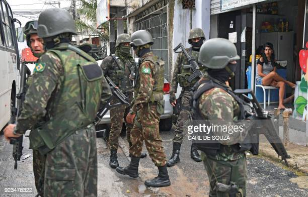 Soldiers patrol close to the Vila Kennedy favela in Rio de Janeiro on February 23 2018 More than 3000 soldiers supported Rio de Janeiro police Friday...