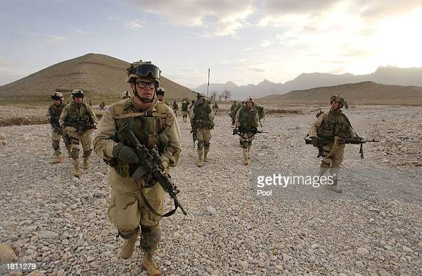 S soldiers patrol during 'Operation Viper' February 19 2003 in the Baghran Valley Afghanistan 'Operation Viper' an operation to search from village...