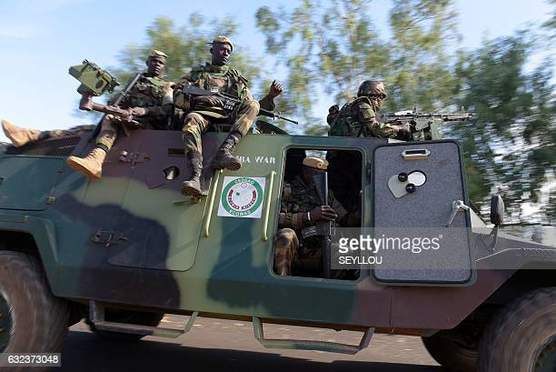 soldiers patrol in front of the Second Battalion Camp in Farafegny on January 22 2017 Gambian leader Yahya Jammeh flew out January 21 from the...