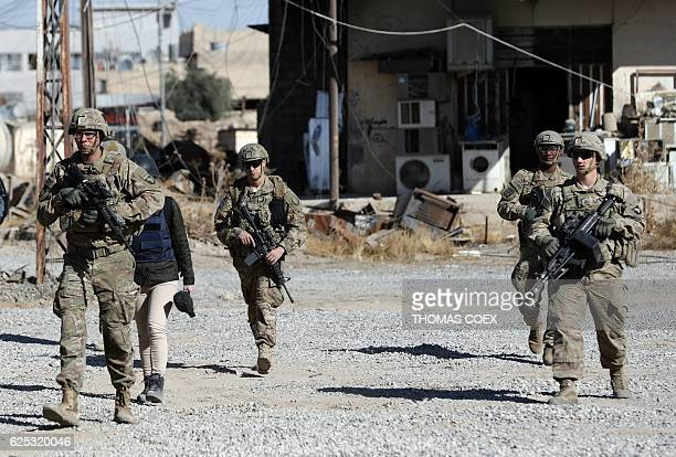 US soldiers patrol near an Iraqi army base on the outskirts of Mosul on November 23 2016 Forces battling the Islamic State group in northern Iraq cut...