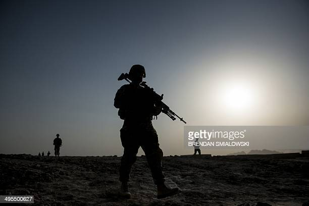 US soldiers patrol near Kandahar Airfield on June 3 2014 Members of the 1st Battalion 12th Regiment 4th Brigade Combat Team 4th Infantry Division...