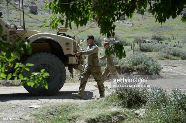 US soldiers patrol near the site of a US bombing during an operation against Islamic State militants in the Achin district of Afghanistan's Nangarhar...