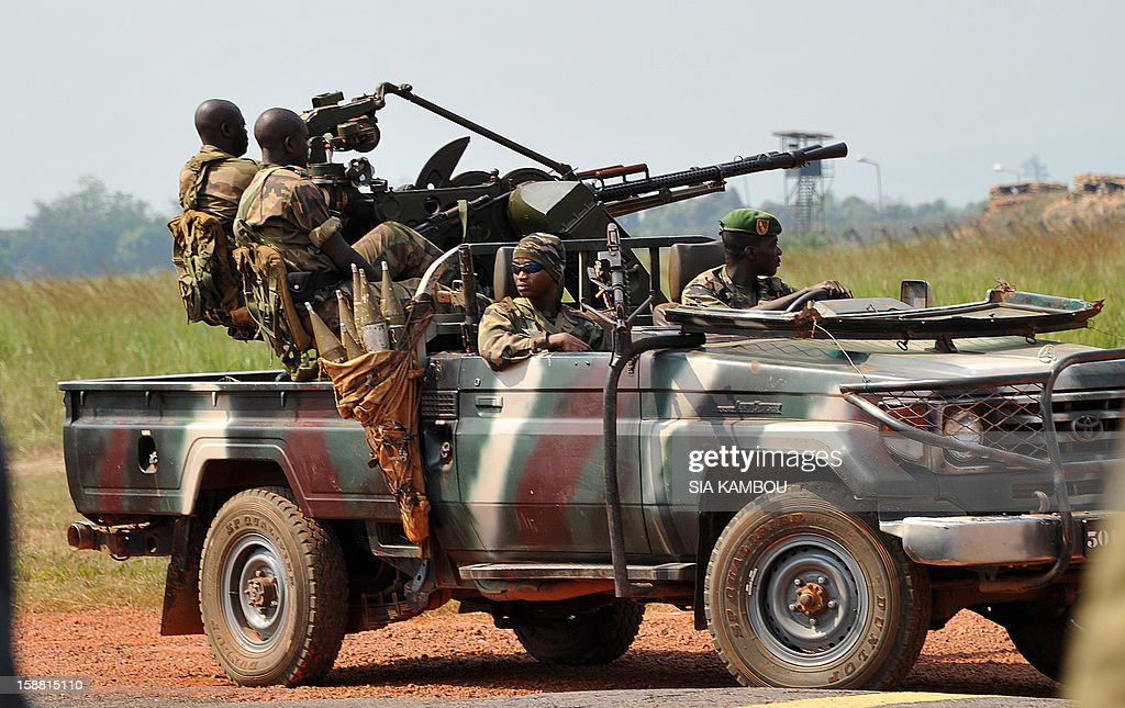 Soldiers patrol on a pick up truck near the airport in Bangui as the President of the Central African Republic greets the current president of the African Union and President of Benin, on December ...