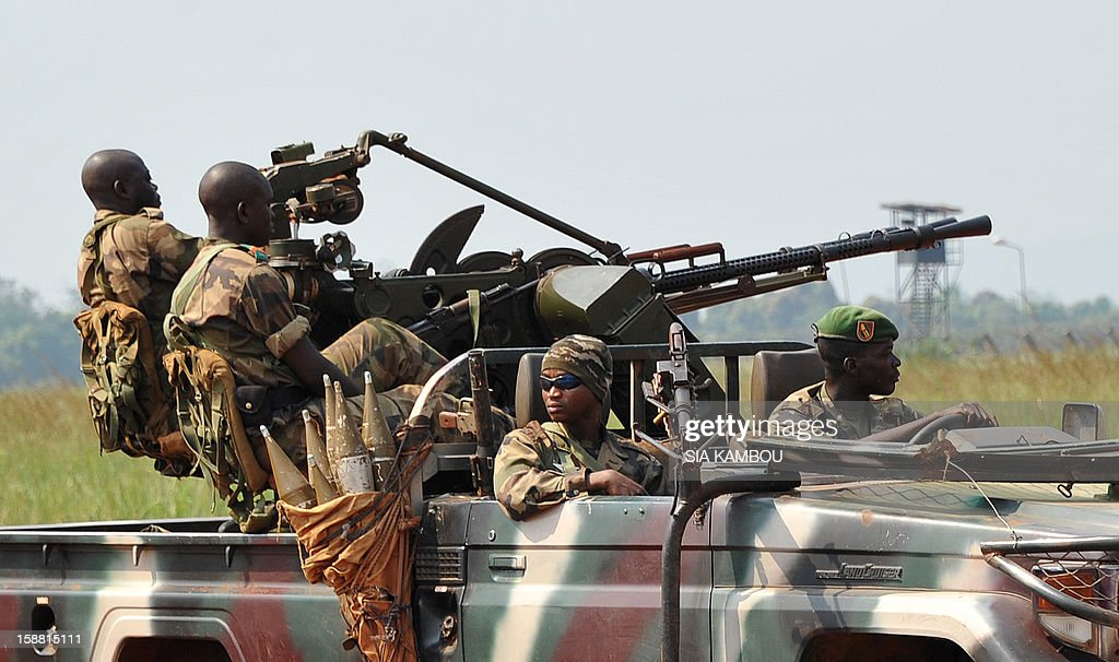Soldiers patrol on a pick up truck near the airport in Bangui as the President of the Central African Republic greets the current president of the African Union and President of Benin, on December 30, 2012. Rebels in the Central African Republic who have advanced towards the capital Bangui warned they could enter the city even as the head of the African Union prepared to launch peace negotiations. Central African President Francois Bozize also stated today he was open to a national unity government after talks with rebel leaders and that he would not run for president in 2016.