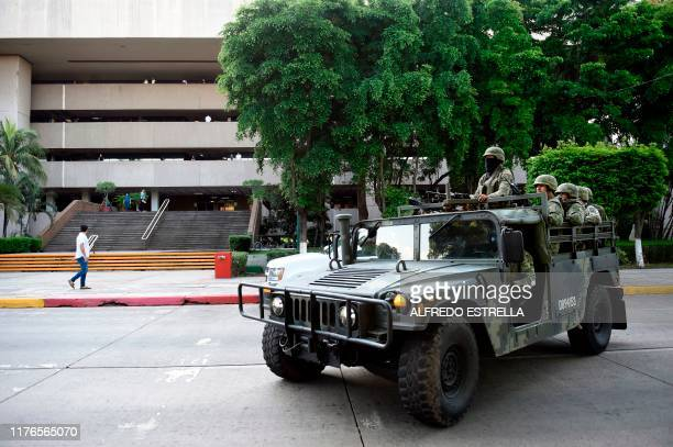 Soldiers patrol outside the government palace in Culiacan Sinaloa state Mexico on October 18 2019 Mexico's president faced a firestorm of criticism...