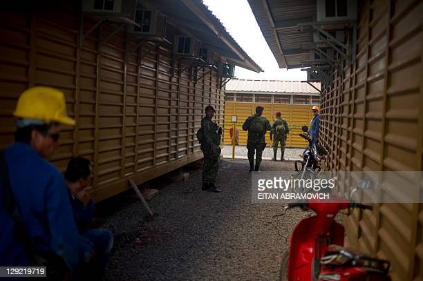 Soldiers patrol the barracks wherethe workers sleep at the Pacific Rubiales' oil field in Rubiales, Meta department, eastern Colombia, on October 5,...