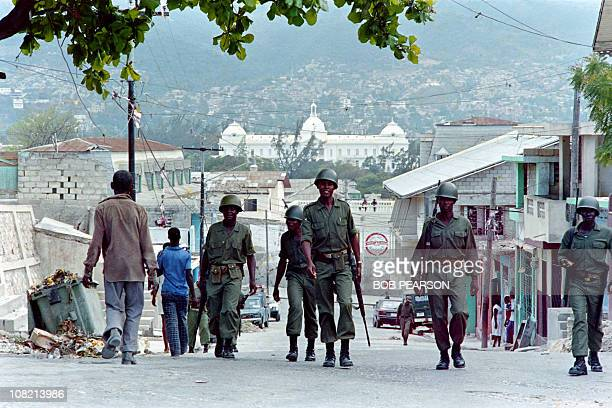 Soldiers patrol the streets of the Bel Air district in PortauPrince on February 08 1986 in order to enforce a 200 PM curfew on the city after...