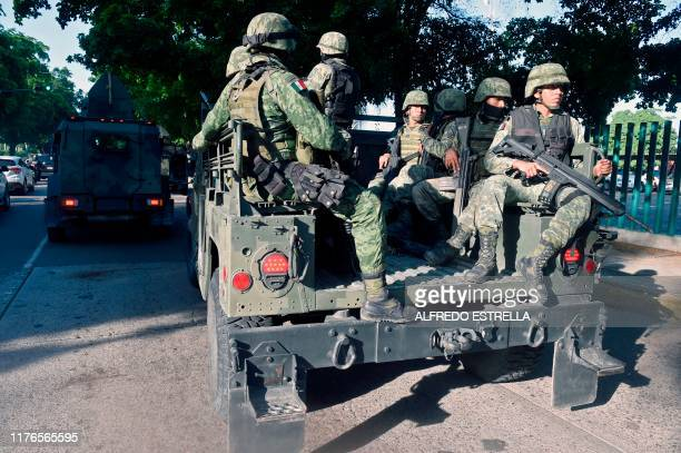 Soldiers patrol the surroundings of the government palace in Culiacan Sinaloa state Mexico on October 18 2019 Mexico's president faced a firestorm of...
