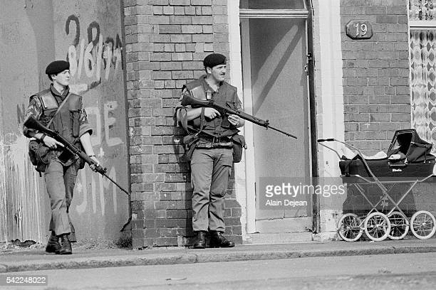Soldiers patrolling in the Catholic area of Belfast where murders and attacks have been particularly numerous