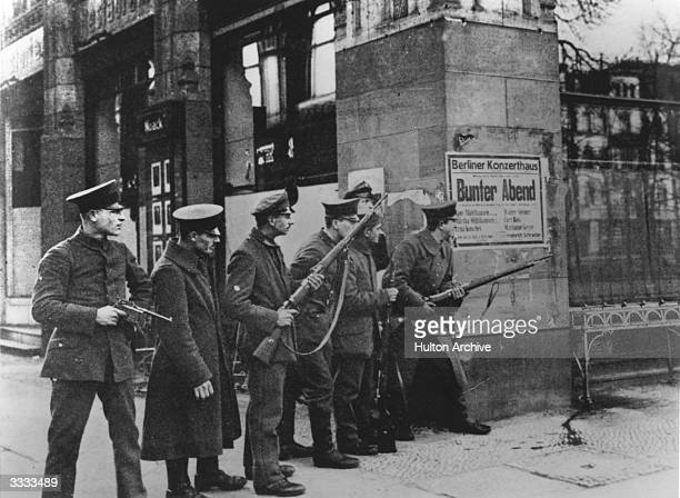 Soldiers patrolling near the Cafe Astoria Unter Der Linden during the Spartacist uprising which broke out in Berlin following Germany's defeat in...