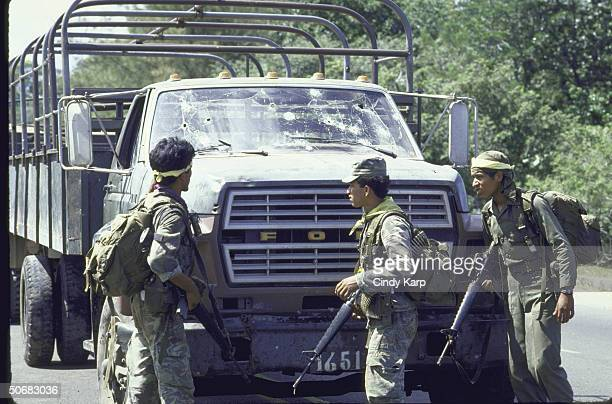Soldiers patrolling site where guerrillas ambused military vehicles