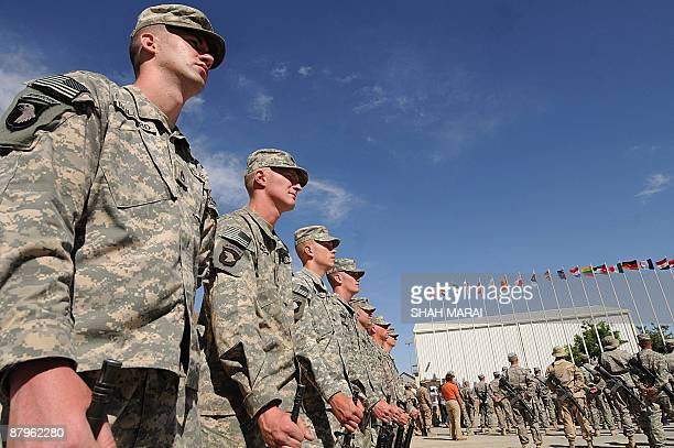 Soldiers pay their respects during a ceremony at Bagram air base, about 50 kms north of Kabul on May 25, 2009. US forces based at Bagram air base...