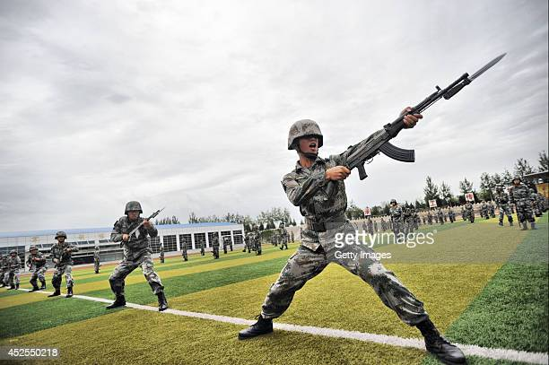 Soldiers perform military exercises at the Academy of Armored Forces Engineering of the PLA on July 22 2014 in Beijing China As the Army Day draws...