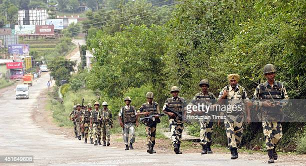 BSF soldiers petrol at Jammu Katra national highway on July 3 2014 in Jammu India Prime Minister Narendra Modi would visit tomorrow to inaugurate...