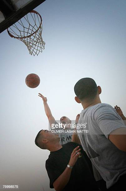 US soldiers play basketball at Camp Warhorse in Baquba 60 kms north of Baghdad 04 August 2007 Five US soldiers have died in Iraq four of whom were...