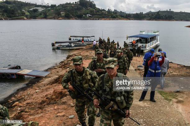 Soldiers police and local authorities arrive at La Manuela a former vacation estate of late drug kingpin Pablo Escobar's family on El Penol reservoir...