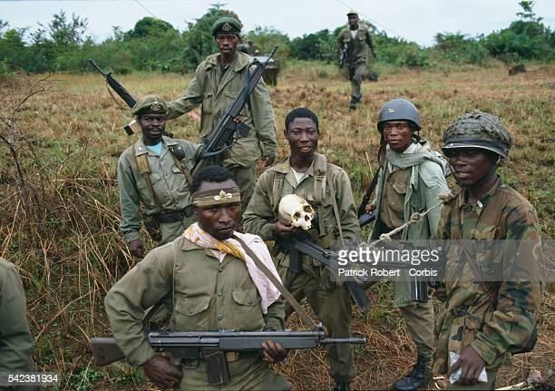 AFL soldiers pose with the skull of a person killed during the Liberian Civil War AFL forces under pressure from Ghanaian ECOMOG forces are defending...